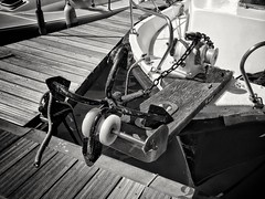 2017-10-06_05-56-58 (georgekells) Tags: boat ship anchor ropes pulley water sea port harbour chain board wood jetty maritime marina sunny contrast texture salou spain uncropped blackandwhite monochrome travel rails metal winch bolts plastic hull