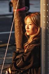 Sunlit (raisalachoque) Tags: sunny smileonsaturday vividorange amber orange street candid korea seoul sunset portrait face sunlit sun