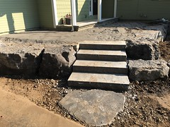Main wall almost finished.  Preparing to lay down limestone tiles. (deroller) Tags: landscaping hardscaping landscape rocks boulders dolomite limestone plantings lighting volt cumberland bay patio front yard remake