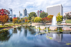 Charlotte North carolina cityscape during autumn season (DigiDreamGrafix.com) Tags: park autumn city skyline marshall charlotte reflection business financial travel scene fall modern architecture building downtown skyscraper urban tourism cityscape north highrise living lake contemporary parks towers metropolitan condos carolina condominiums uptown sky nc