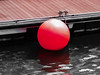 A Big Red Spot (Steve Taylor (Photography)) Tags: ball jetty buoy rope black grey brown red wood water asia city singapore