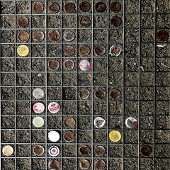 downtrodden (fourcotts) Tags: fourcotts square iphone7 berlin grating bottle tops caps crown yellow white red rust earth dirt squares grid underfoot downtrodden