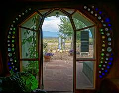 Earthship doorway (rovingmagpie) Tags: newmexico taos earthshipbiotectureworldheadquarters earthships earthship bday2017 doorway bottles