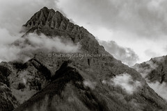 Moody Clouds (Shutterbytes by Michele Hamilton) Tags: canada july2015 rockymountaineer blackandwhite clouds monochrome sky canadian rockies landscape mountains peak pinnacle storm weather