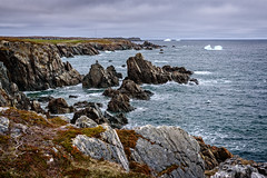 Rough shore and icebergs (Brett of Binnshire) Tags: shoreline water mountains highdynamicrange weather waves hdr bonavista lrhdr on1raw ocean manipulations scenic lightroomhdr iceberg newfoundland canada locationrecorded cliff mountain