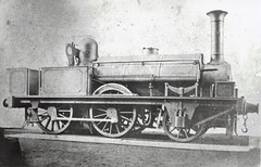 "A British 2-4-0 steam locomotive (1846) by HISTORICAL RAILWAY IMAGES - An early model type British ""open cab"" 2-4-0 steam locomotive, built in 1846. Specific details unknown."