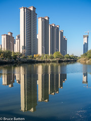171030 Tianjin-02.jpg (Bruce Batten) Tags: trees locations shadows lighthouses trips occasions plants subjects reflections buildings tianjin lakesponds businessresearchtrips china urbanscenery tianjinshi cn