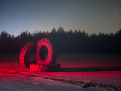 Red Light Glow (karlogd) Tags: tires worn out old street road lights playing with trees space sky stars galaxy cosmos grass earth planets night nightphoto nightphotography astro longexposure longexposureshot longexposurephoto exposure universe beautiful starrynight skyshot nature olympus omd em10 markii panasonic lumix 25mm 17 red