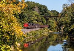 Whiffs of Fall (Wheelnrail) Tags: cn canadian national ble bessemer lake erie locomotive iron ore conneaut ohio fall railroad rails trains train emd sd60 reflection