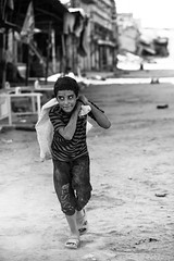 Carrying the weight of Mosul war against ISIS (Giulio Magnifico) Tags: weight boy iraq refugees mosul da3sh city oldcity 105mm naturallight d800e war kurdistan italy iraqturchia destroyed dust isis blackandwhite candid fear detail nikond800enikkor105mmmicrof28afs ruins middleeast civilwar child