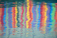 reflection of a summer day: beach towels reflected in the pool.jpg (remiklitsch) Tags: pool towels reflection beachtowel vibrant colors abstract pattern ripples nikon remiklitsch red orange yellow green blue violet fuschia