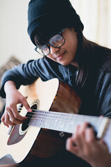 Young girl play guitar (Patrick Foto ;)) Tags: acoustic artist asian attractive background beautiful beauty caucasian child classical concept cute education face female fun girl guitar guitarist happy holding instrument joy kid kids learn leisure little music musical musician one outside people person play player playing portrait pretty smile song sound string teenager thai white woman young youth