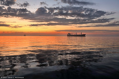 Coming In (David C. McCormack) Tags: americana boat eos eos6d environment greatlakes harbor lakemichigan lakefront lake midwest milwaukee outdoor sunriseset sunrise wisconsin water freighter ship