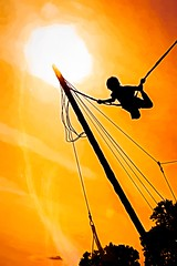 Flying Too Close? (Wes Iversen) Tags: holly michigan michiganrenaissancefestival nikkor18300mm painterly rider rides ropes silhouettes sun texture kids boys