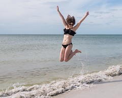 Jump! (Oliver Leveritt) Tags: nikond610 afsnikkor1635mmf4gedvr oliverleverittphotography wideangle girl woman cute pretty sexy bikini beach ocean florida stpetersburg treasureisland jump leap