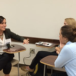 Students talk with an alumna at the Professional Networking Symposium