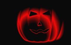 wishing you a scary halloween (HansHolt) Tags: halloween scary pumpkin pompoen face candle flame light bottomlit gloomy spooky frightful round rond orange oranje macro canon 6d 100mm canoneos6d canonef100mmf28macrousm macromondays hmm