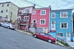 Streets of St. John's (gabi-h) Tags: brightlycolouredhouses jellybeanrow steephill clapboard newfoundlandandlabrador stjohns gabih street hill cars automobile sky pavement road windows windowswednesday steps stairs bicycle scaffolding ladder doors