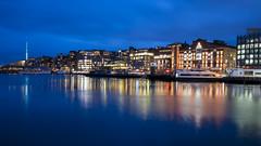 Aker Brygge blue hour (HansPermana) Tags: norway norwegen oslo city cityscape hafen wharf bluehour longexposure buildings cloudy autumn lights reflection water
