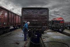 maintenance (dim.pagiantzas | photography) Tags: maintenance peop man men male worker work transportation trains wagon cargo old station textures metal atmospheric rails sky railroad clouds cloudy rainy humidity dull canon light machine wheels outdoor train