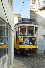 A tight squeeze in Lisbon (gooey_lewy) Tags: lisbon tram 28 classic old electric steep tourist yellow colour road building architecture 12 atightsqueeze squeeze tight gap slit between buildings hole space void reflection window glass 558 flange squeal squealing