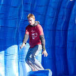 A student tries out the surfing game at the Red and White Week Kickoff