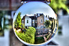 Neighbours (Geoff Henson) Tags: houses spherical crystalball inverted hedge fence roofs chimneys windows swing chairs table sky reflection