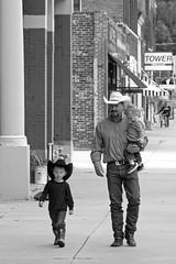 Cowboy and His Son (DJ Wolfman) Tags: street streetshots people streetphotography blackandwhite bw cowboys hat olympus olympusomd micro43 zuiko 12100mmf4zuiko zd