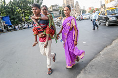 Mumbai, India (gstads) Tags: mumbai bombay india indian street streetscene streetphotography maharashtra people sari cripple piggyback road handicap handicapped paralyzed carry heavy load disabled family care caring