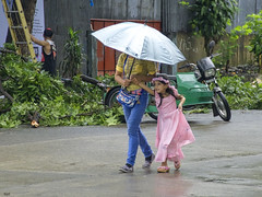 Hurry (Beegee49) Tags: girl daughter mother rain pretty pink dress bacolod city philippines