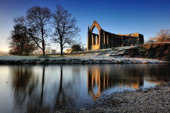 Dawn at the Abbey (images@twiston) Tags: dawnattheabbey winter boltonabbey dawn dawnatboltonabbey ruins augustinian priory parish churchofsaintmaryandsaintcuthbert churchofstmaryandstcuthbert bolton abbey monastery sunlight golden hour yorkshiredalesnationalpark river wharfe dissolutionofthemonasteries 1154 devonshire estate northyorkshire stone imagestwiston morning national park yorkshire blue sky cloudless frost frosty cold freezing reflections tree trees branch branches landscape dales reflected godsowncountry le longexposure 10stopnd rocks pebble rock pebbles stones tributary brook flowing stream