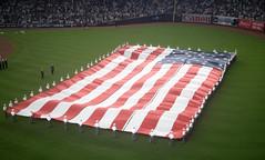 A giant American flag is unfurled at Yankee Stadium prior to Game 3 of the 2017 American League Division Series. (apardavila) Tags: americanleaguedivisionseries americanflag baseballyankeestadium mlb majorleaguebaseball newyorkyankees usa yankees yanks flag postseason sports