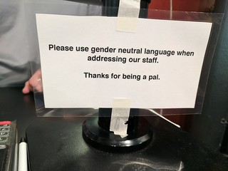 Pronoun advice sign, Taco Cat, Minneapolis, Minnesota, USA