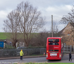 Reversing The Bus Back (M C Smith) Tags: red scania pentax k3 people man woman pylons trees railings fence sky blue clouds white reversing hivi slope bus telegraph pole cone