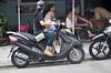 Peekaboo! (Roving I) Tags: peekaboo boys babies sons mothers helmets food motorscooters cafes woodenfurniture streets danang vietnam children