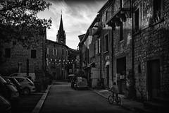 A boy on a bike (cliveg004) Tags: ardeche berrias france limestone buildings lowsun shadows bw mono blackandwhite lardechoise stone churchspire nikon d5200