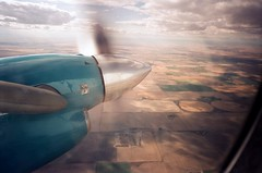 2a (.grux.) Tags: minolta af50bigfinder film 27mmlens svemacolor125 expiredfilm window propeller fields prairie clouds sky airplane beechcraft1900d alberta