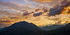 Purple wanderer (Marc R. A.) Tags: italy lago como sunset landscape nature clouds sun mountain hills soft fluffy