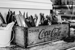 91/100: Diet Coke Break... (judi may) Tags: newzealand 100xthe2017edition 100x2017 image91100 tirau crate woodencrate cocacola cutlery table monochromebokehthursday monochrome mono blackandwhite wood bucket metal napkins bokeh dof depthoffield cafe canon7d 35mm
