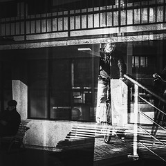 Biker, Ostend, Belgium (janbeernaert) Tags: belgium x bike blackandwhite dark fujifilm fujifilmxe3 fujilove ostend reflection street streetphotography urbanlandscape window xe3 zwartwit