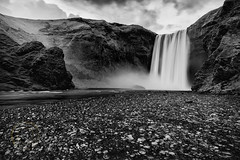 Skógafoss (Simone Della Fornace) Tags: skogafoss waterfall iceland travel traveldestination beautyinnature nature outdoor tourism touristicdestination landmark landscape blackandwhite day mist water longexposure motion mountains nopeople wide zeiss sony monochrome rocks