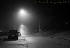 Quiet Night (Mono) (13skies) Tags: nightshot nighttime street westriverst parison foggy mist sonya57 parkedcars streetlights safety quiet silent longexposure tripod night light vehicles signs distance