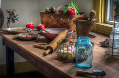 A kitchen of long ago. (donnieking1811) Tags: tennessee nashville grassmerezoo kitchen jar rollingpin eggs tomatoes lettuce bellpeppers vegetables kitchentools basket bowls jaropener table window hdr canon 60d lightroom photomatixpro