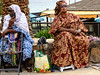 colourful ladies (drjacquebaxter) Tags: ladies colour street streetphotography selling commerce africa culture dresses nationalcostume ngc