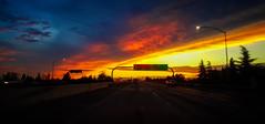 I'VE SEEN IT RAININ' FIRE IN THE SKY (akahawkeyefan) Tags: freeway 180 fresno sky sunset davemeyer signs cars road photograbswhiledriving