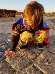 SuperBatman and Vincent's stone (quinn.anya) Tags: sam preschooler batman superman superhero stone vincent sunset memorial edgartown marthasvineyard