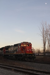 Light is fading quickly and the moon has made its appearance in the sky above CN 2031 as I await the departure of the empty grain train from the ethanol plant in Shelby, NY. (u18b404) Tags: moon cn ge medina grain ethanol frr