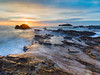Sunset at Godrevy (Michael Sowerby Photography) Tags: 2017 august cornwall evening seascape sunset water coast landscape sea sundown rocks 5dsr landscapephotography lighthouse godrevy rocky flow sky sun clouds canon 1635mm