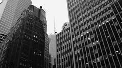 Midtown Buildings (Zach K) Tags: buildings skyline skyscrapers structure towers midtown westmidtown nyc new york city manhattan bryant park area boa tower bank america black white bw blackandwhite blackwhite fujifilm x100f urban design built environment builtenvironment curtainwall masonry structures acros