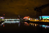 Dark Is the Way, Light Is a Place (stckrboy) Tags: secc olympus pen clydeauditorium conferencecentre olympuspen reflections armadilo outdoor clyde water architecture epl7 longexposure illuminated crane scotland penepl7 river dark lights night sky shimmer auditorium sec lightroom glasgow